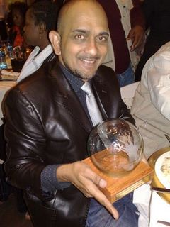 Nirmal Shah displays the coveted trophy